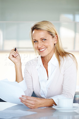 Buy stock photo Portrait of a happy young businesswoman holding a paper in office