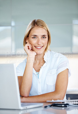 Buy stock photo Portrait of a beautiful businesswoman sitting at her desk with a laptop smiling