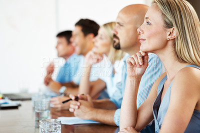 Buy stock photo Portrait of a serious business men and women attending a seminar - Paying attention