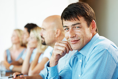 Buy stock photo Successful mature businessman attending a seminar with his associates at office