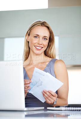 Buy stock photo Portrait of a successful young businesss woman holding a envelope while working in office
