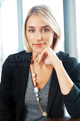 Buy stock photo Portrait of a beautiful young woman looking confidently at you
