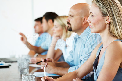 Buy stock photo Portrait of a pretty young businesswoman sitting in a meeting with business colleague