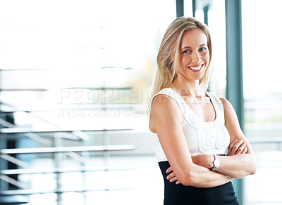 Buy stock photo Portrait of a happy young casual businesswoman standing with her hand folded
