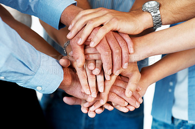 Buy stock photo Closeup of a business colleagues with their hands stacked together
