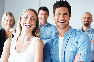 Buy stock photo Portrait of a excited young man and woman standing with people in background