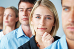 Smart young businesswoman standing in row with colleagues