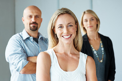 Buy stock photo Portrait of a cute young woman smiling with colleagues at the background