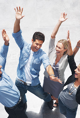 Buy stock photo Top view of group of business people raising hands in joy - Success