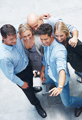 Buy stock photo Top view of happy young group of people taking self portrait