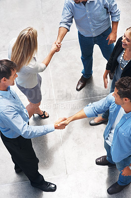 Buy stock photo Top view of successful business colleagues shaking hands