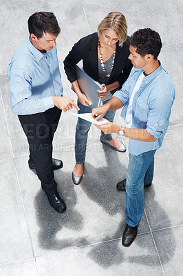 Buy stock photo Top view of group of business colleagues discussing business issues