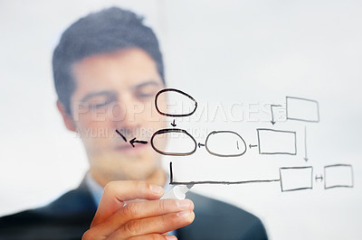 Buy stock photo Male executive drawing a diagram representing success