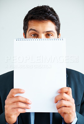 Buy stock photo Male executive holding up notepad