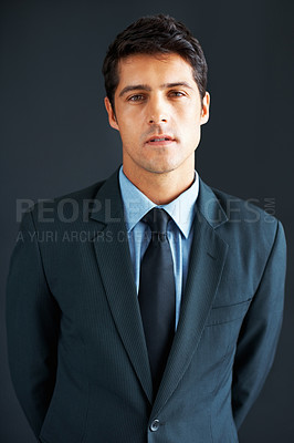 Buy stock photo Serious executive in suit posing