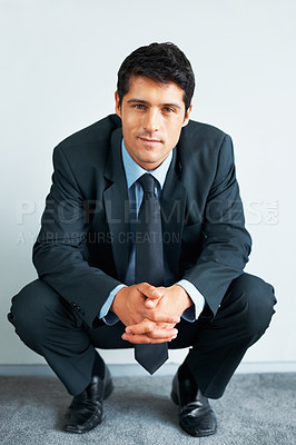 Buy stock photo View of businessman crouched down