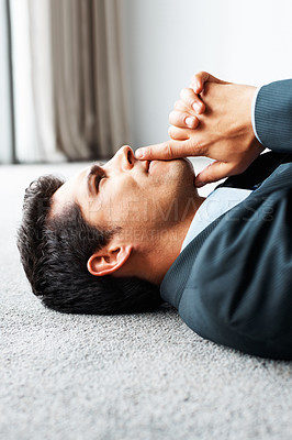 Buy stock photo Executive lying on floor with finger on lips