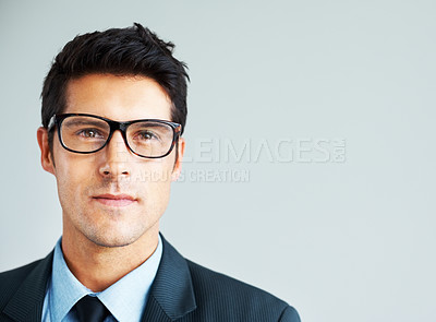 Buy stock photo Young businessman looking at you on white background