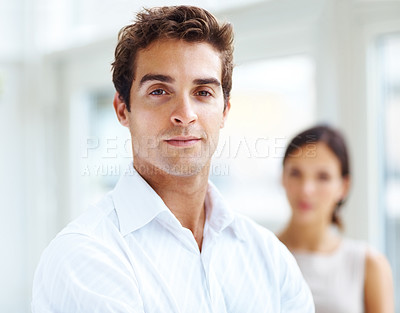 Buy stock photo Portrait of happy young man with a woman in background