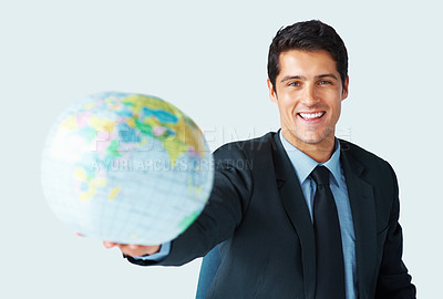 Buy stock photo Executive holding out globe on white background