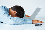 Exhausted executive resting on laptop