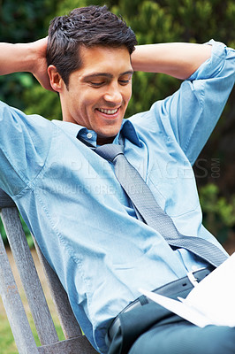 Buy stock photo Executive sitting and smiling with hands behind his head