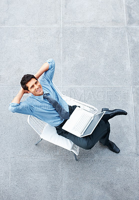 Buy stock photo Top view of happy executive with laptop sitting outdoors