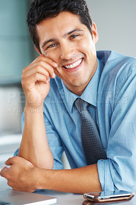 Buy stock photo Portrait of businessman with hand on face and cell phone near by