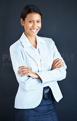 Buy stock photo Business woman standing casually on blue background