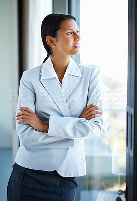 Buy stock photo Executive standing casually against window