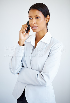 Buy stock photo Business woman listening to mobile phone against white background