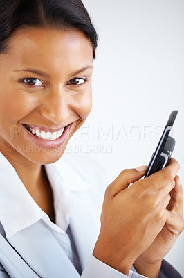 Buy stock photo Smiling businesswoman typing an sms, isolated on white - copyspace