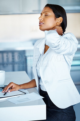 Buy stock photo Business woman taking break to stretch neck indoors