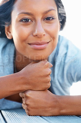Buy stock photo Pretty woman resting her chin on her hands