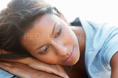 Buy stock photo Pretty woman resting her head on a table outdoors