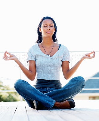 Buy stock photo Attractive woman meditating in lotus pose outdoors