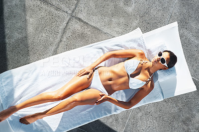 Buy stock photo Top view of woman lying on chair with hands on her hips, sunbathing