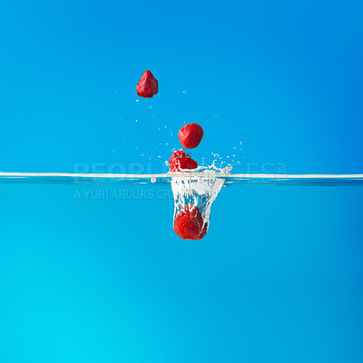 Buy stock photo View of strawberries falling into water