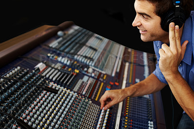 Buy stock photo Charming young guy in sound recording studio working with sound mixer control desk