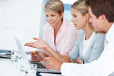 Buy stock photo Portrait of confident business woman explaining a project to colleagues at the office