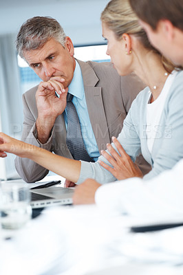 Buy stock photo Young business woman presenting her ideas to boss during a meeting at office