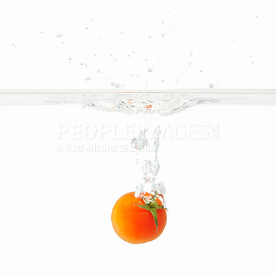 Buy stock photo View of small tomato falling into water against white background