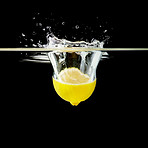Half lemon falling into water