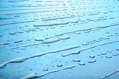 Buy stock photo Rows of water drops making diagonal pattern on blue