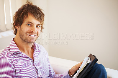 Buy stock photo Happy young business man with file folder at office - copyspace
