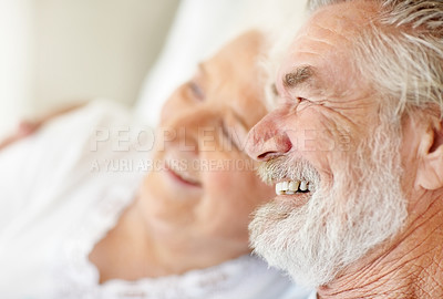 Buy stock photo A happy senior couple having a laugh while enjoying each others' company