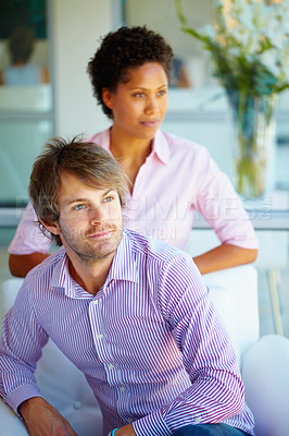 Buy stock photo Young business man and woman looking away
