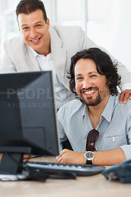 Buy stock photo Successful business men smiling while working on computer
