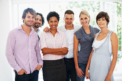 Buy stock photo Portrait of confident business people standing together in office