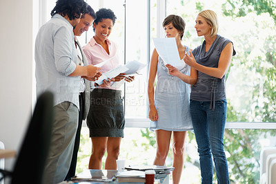 Buy stock photo Group of business people reading documents in the office